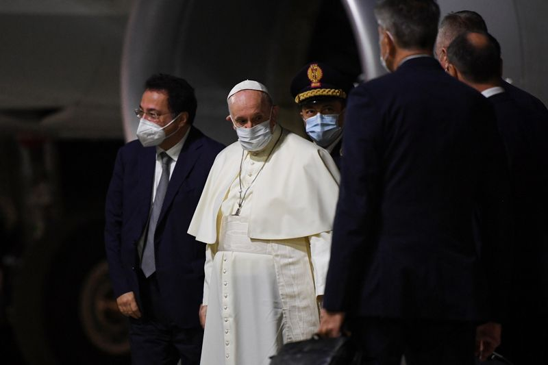 Pope Francis arrives to board the plane for his visit to Hungary and Slovakia, at Fiumicino Airport near Rome