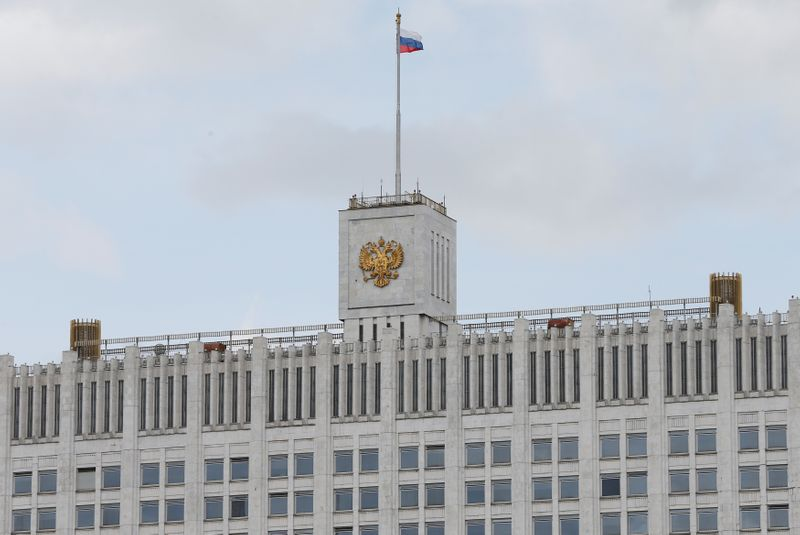 FILE PHOTO: National flag flies over Russian government headquarters in Moscow