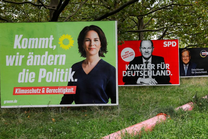 FILE PHOTO: Top candidates for the German Chancellery feature on election campaign billboards