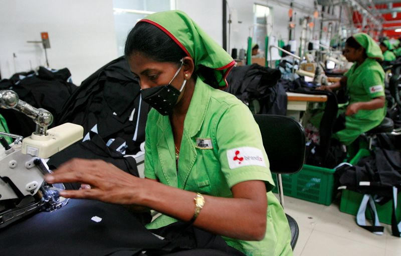 FILE PHOTO: File photo of garment workers sewing pants in a Brandix factory in Colombo