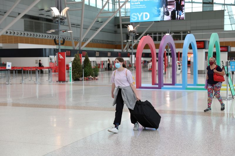 FILE PHOTO: People walk through the domestic terminal at Sydney Airport in Sydney, Australia