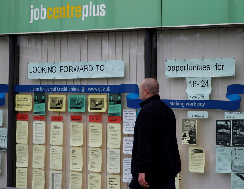 A man walks past a job centre following the outbreak of the coronavirus disease (COVID-19), in Manchester