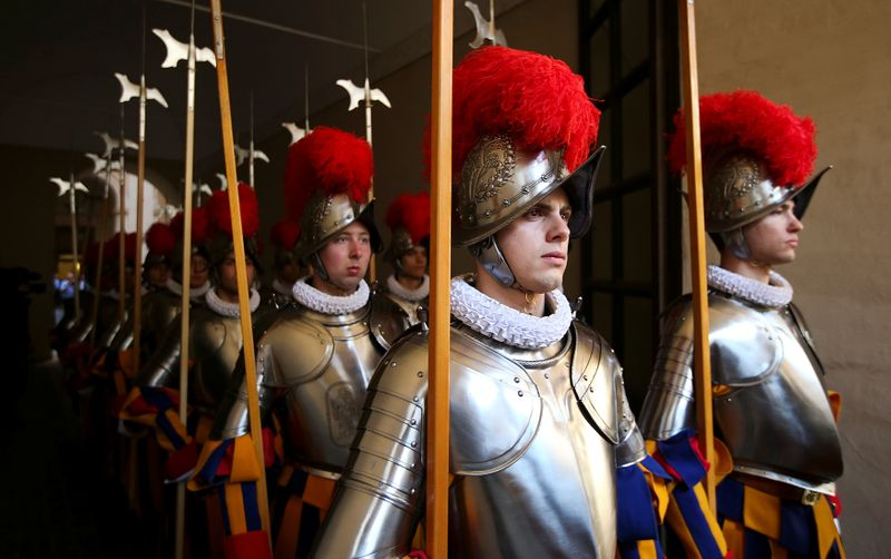 New recruits of the Vatican's elite Swiss Guard march during a swearing-in ceremony at the Vatican