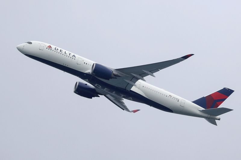 FILE PHOTO: A Delta Air Lines plane takes off from Sydney Airport in Sydney