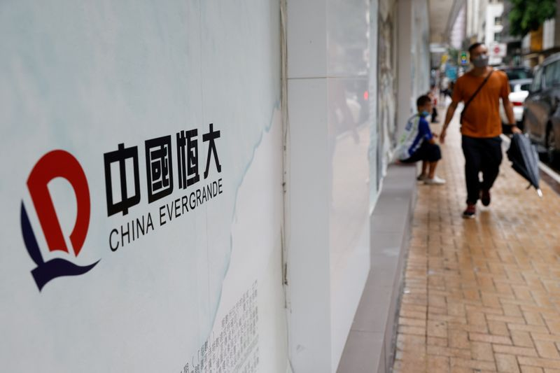 FILE PHOTO: The logo of China Evergrande is seen at outside China Evergrande Centre building in Hong Kong