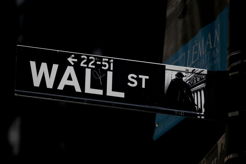 FILE PHOTO: A Wall St. street sign is seen near the NYSE in New York