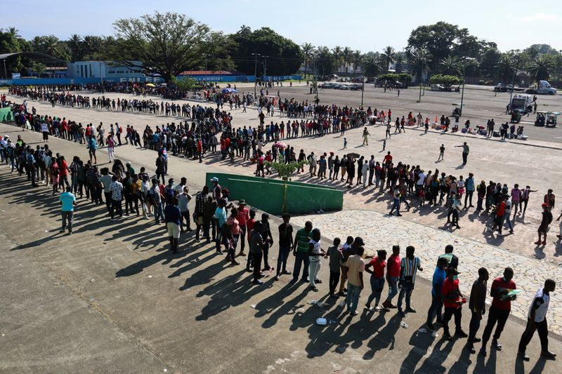 Migrants wait for asylum processing, in Tapachula