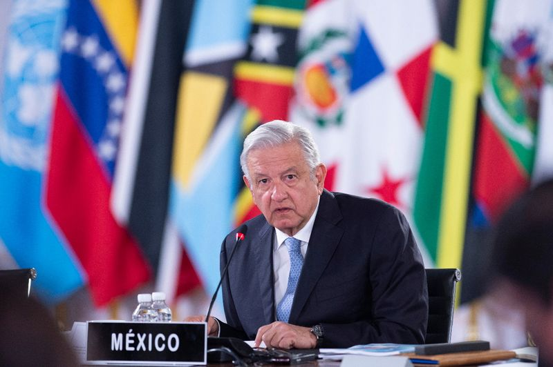 Mexico President Andres Manuel Lopez Obrador listens during the summit of the Community of Latin American and Caribbean States (CELAC), in Mexico City