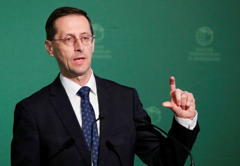 FILE PHOTO: Hungarian Finance Minister Mihaly Varga speaks during a business conference in Budapest