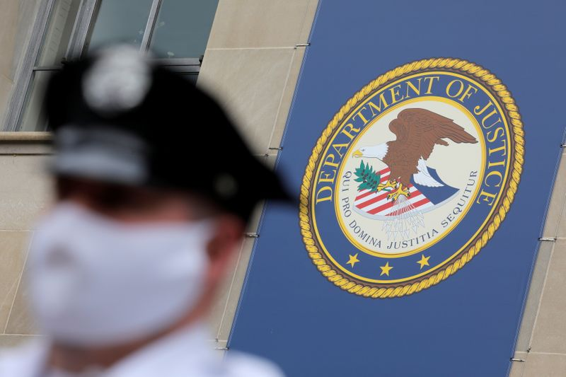 Security stands guard at the headquarters of the United States Department of Justice (DOJ) in Washington, D.C.