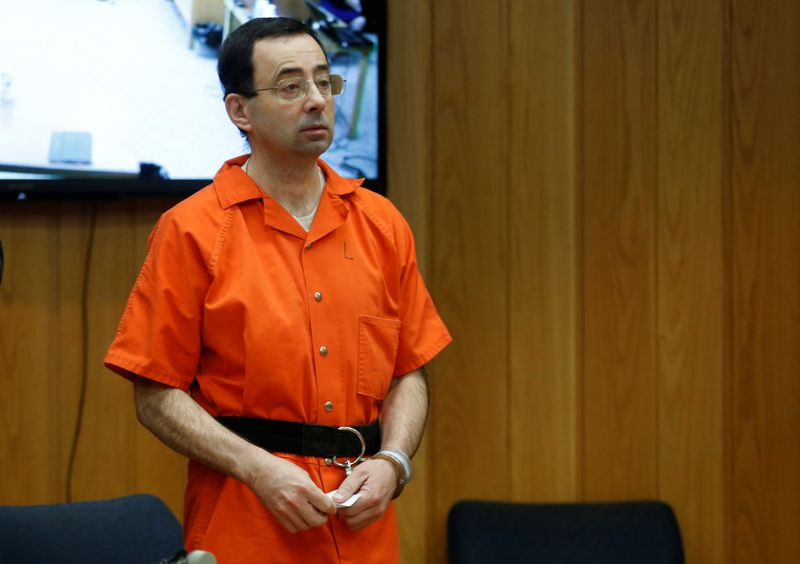 Larry Nassar, a former team USA Gymnastics doctor who pleaded guilty in November 2017 to sexual assault charges, stands in court during his sentencing hearing in the Eaton County Court in Charlotte