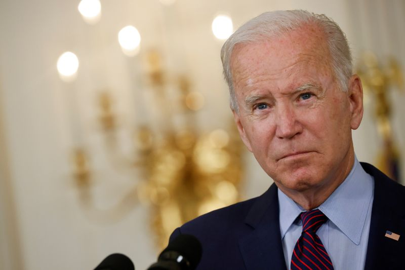 FILE PHOTO: U.S. President Joe Biden looks on as he delivers remarks on the U.S. debt ceiling from the State Dining Room of the White House