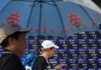 Asian markets edge lower; Turkish lira holds onto overnight gains