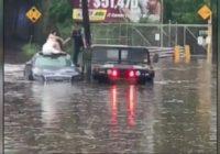 WATCH: Flash floods wash cars off dealership
