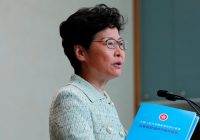 Hong Kong leader halts policy speech as lawmakers disrupt session