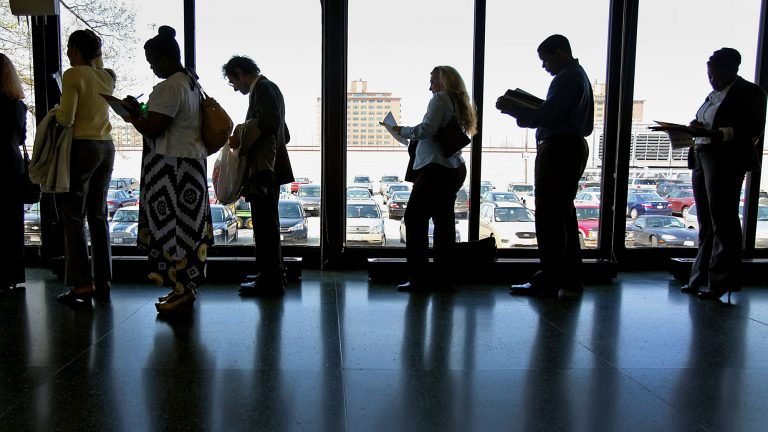 Job openings slide by more than half a million as the labor market tightens