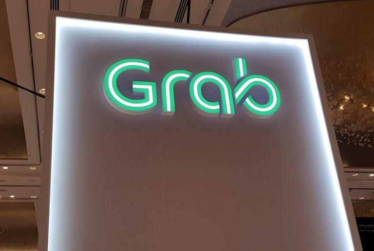 SoftBank-backed Grab raising $856 million from Japanese investors