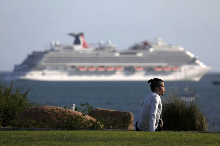 Cruise operator Carnival pays high price to get credit investors on board
