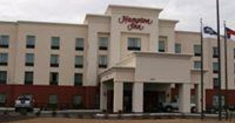 Black family sues Hilton after police called for inn's bill error