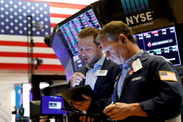 Dow seesaws back into positive territory in volatile session